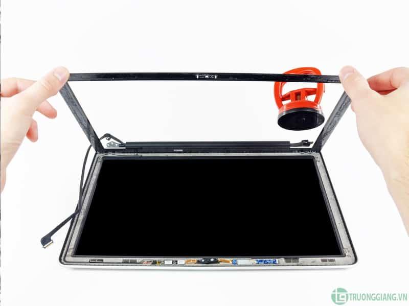 Thay mặt kính Macbook